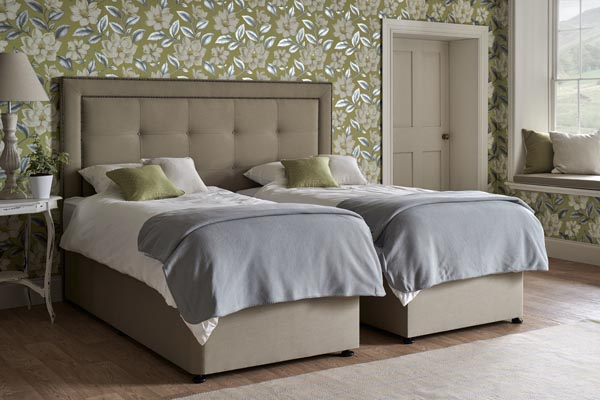 Floor standing Emperor Jura Headboard with zip and link two piece Superking Jersey Divan and Mattress Set split to give two 3ft single beds.