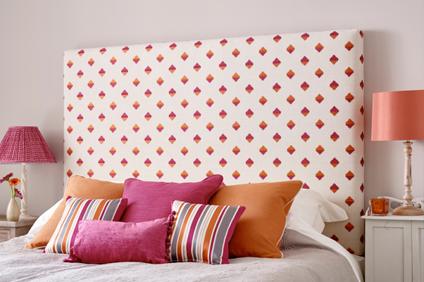 Simple Padded Tall Arran Headboard upholstered in Boutique Diamond Pattern Red Pink Orange Rust