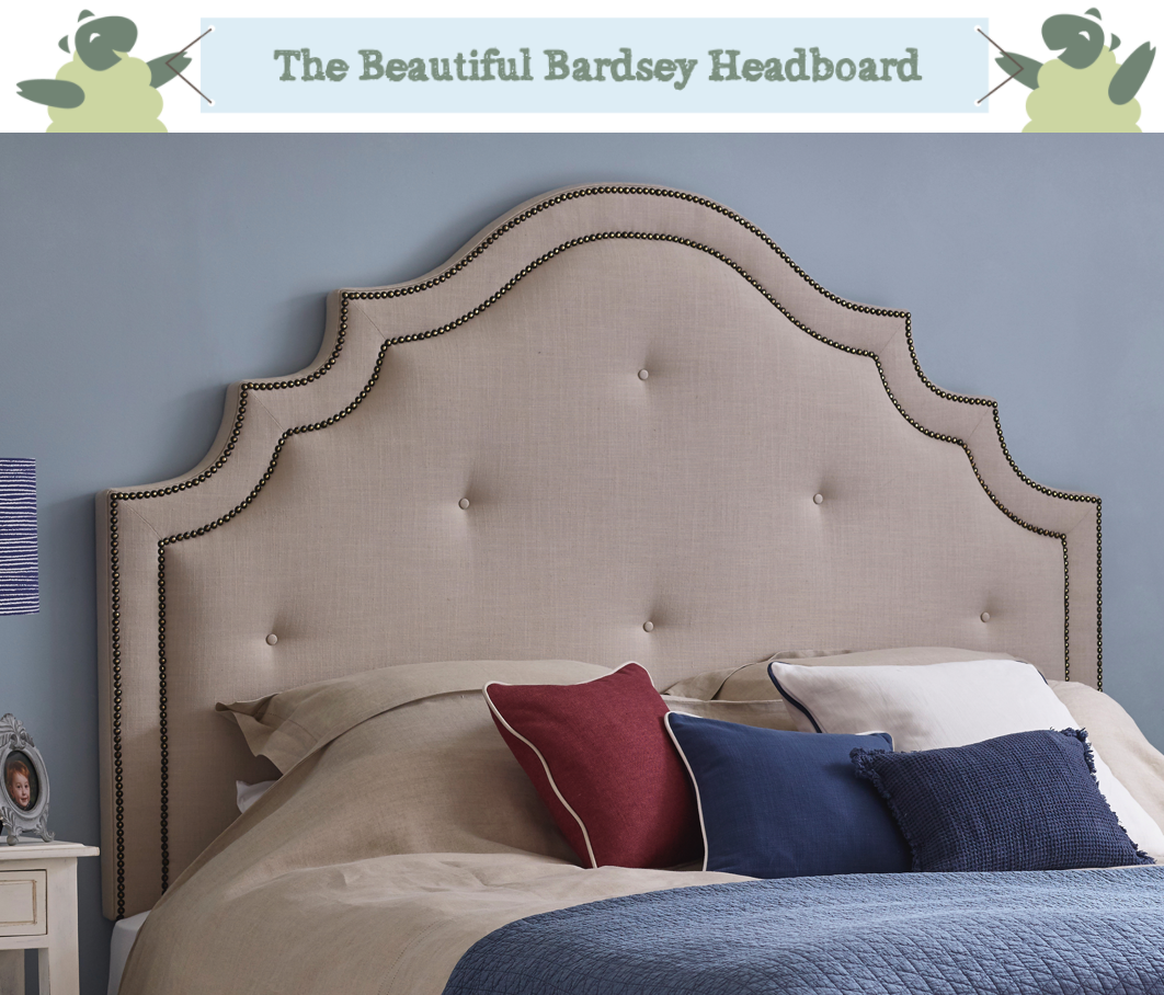 Ornate Curved Shape with Border and Buttons Bardsey Headboard upholstered in House Linen Stone Natural Fabric with Contrast Vintage Studs and Self Buttons in a Farrow and Ball Parma Grey painted room, coastal theme