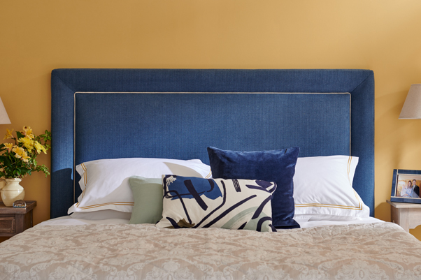 Ghia Padded Border Headboard upholstered in House Chenille Navy with Contrast Piping in Pure Cotton Natural