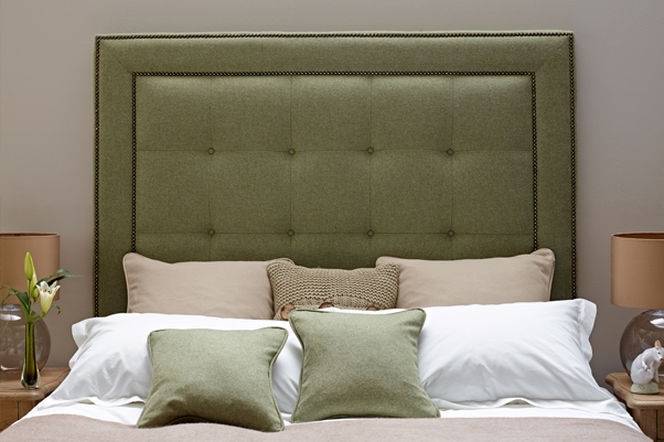 Studded Border Jura Headboard upholstered in Pure New Wool Plain Willow Green, with Vintage Studs and Self Buttoning in a Farrow & Ball Painted Room