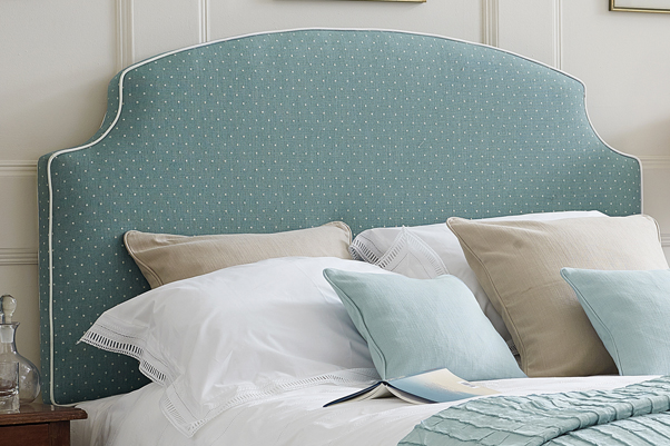 Cottage Style Arched Curve Puffin Headboard upholstered in Linen Spot Wedgwood Blue Fabric with Contrast Piping in Pure Cotton Natural in a Farrow and Ball Cornforth White painted room