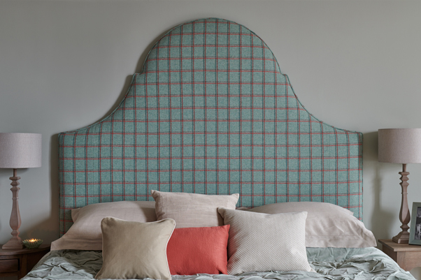 Tall Curved Period Style Rhum Headboard upholstered in Pure Wool Check Duck Egg and Pink and Contrast Piped in Pure Cotton Coral in a green floral wallpapered room