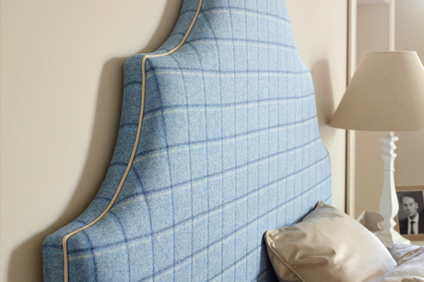 Ornate Curved Shape Samson Headboard upholstered in Pure Wool Check Wedgwood Blue, with Contrast Piping in Pure Cotton Natural in a Farrow and Ball painted room