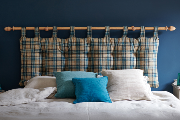 Sheppey Hanging Cushion Style Headboard upholstered in Pure Wool Plaid Teal Blue in a Farrow and Ball Hague Blue painted room