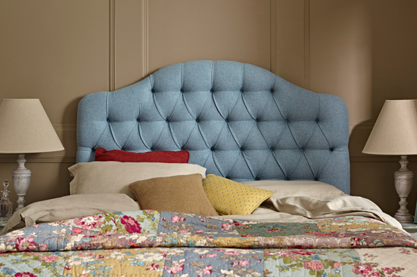 Tean Deep Buttoned Humped Headboard upholstered in Pure Wool Plain Wedgwood Blue Eau De Nil with Self Buttons against Farrow and Ball painted room