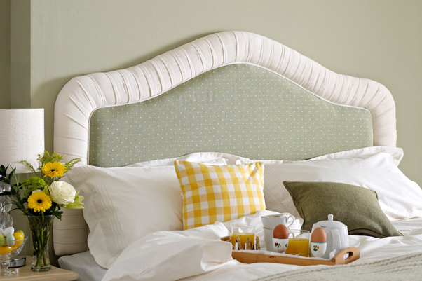 Tresco Classic Curved Pleated Headboard upholstered in Linen Spot Lichen with a contrast border in Pure Cotton Snow in a Farrow and Ball - Ball Green painted room
