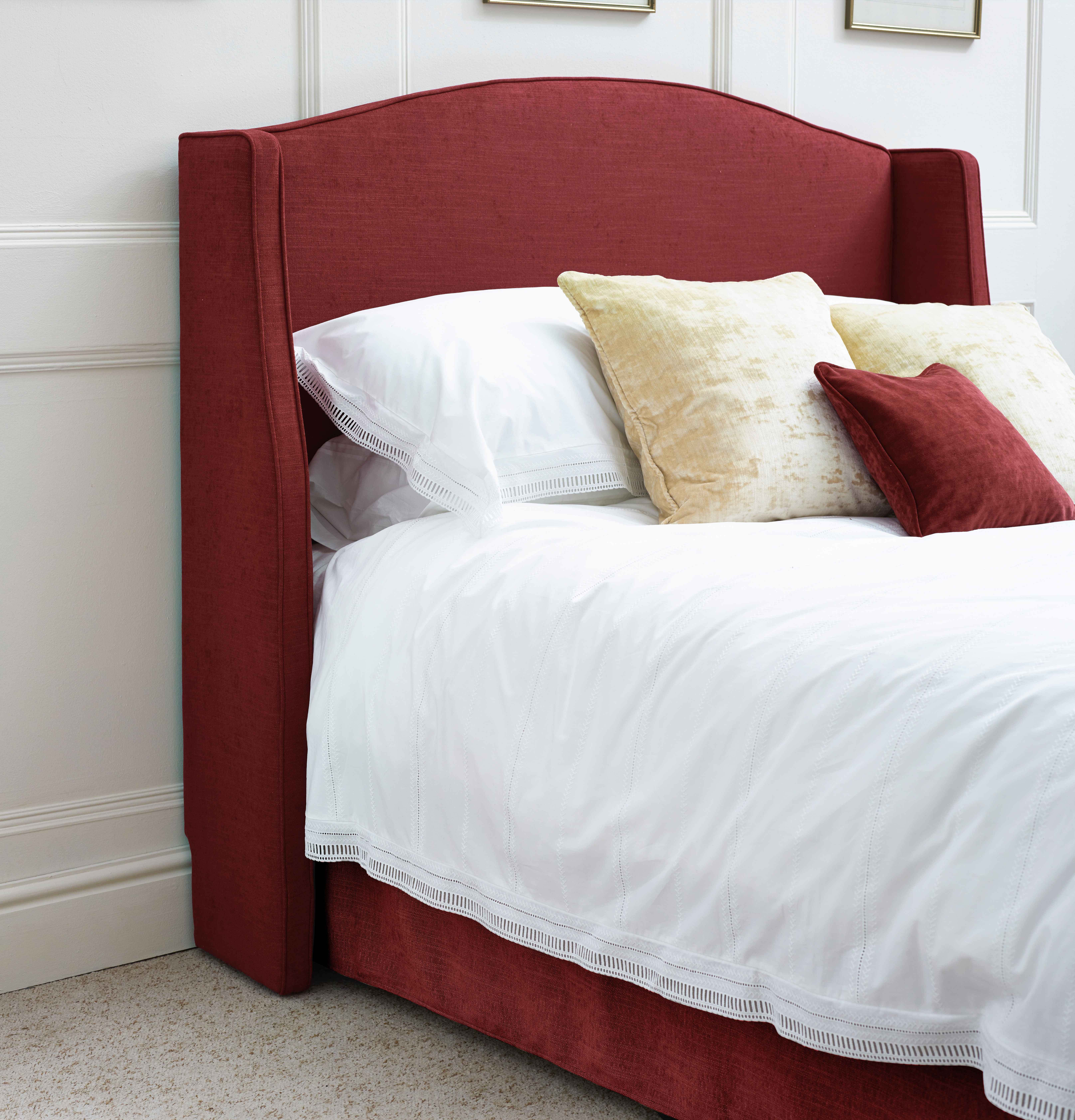 Winged Caldey Headboard in House Weave Ruby with skirting board cutout