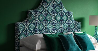 Blue Green Linwood Kami Velvet Seagrass on a curved ornate headboard