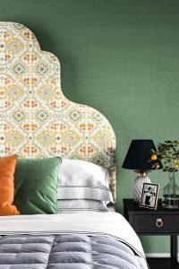 Large ornate bed upholstered in Linwood Kami Jade Velvet