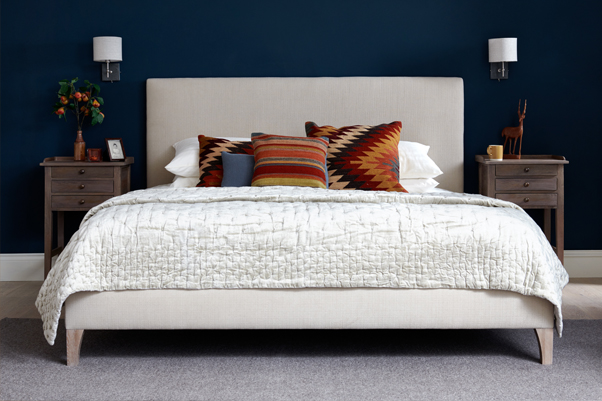 Simple Contemporary Arran Grand Upholstered Bed upholstered in House Chenille Stone in a Farrow and Ball Hague Blue painted room