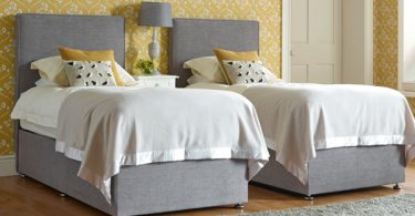 The Clever and Practical Coll Zip & Link Bed with removable cover, covered in House Weave Light Grey