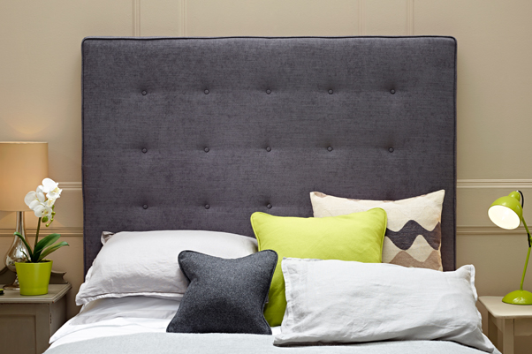 Mull Bed Headend with shallow buttoning in House Weave Slate with lime and grey accessories